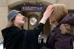 Outside the Church, Giving Ashes to Busy Commuters